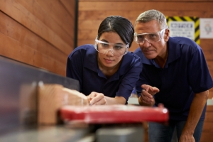 Carpenter with apprentice by Shutterstock.com/Monkey Business Images