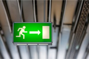 Exit sign by Shutterstock.com/photoinnovation